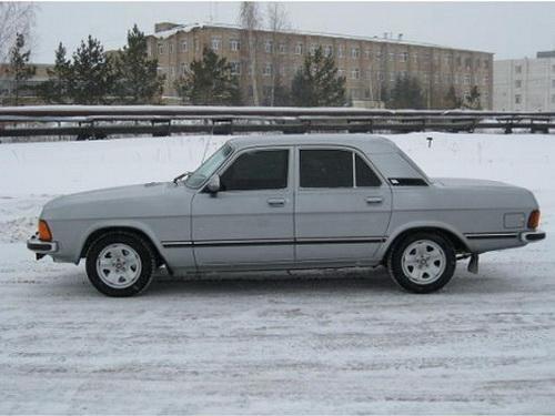 Серый ГАЗ 3102 вид сбоку
