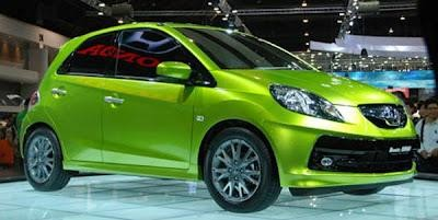 Милый зеленый Хонда Брио