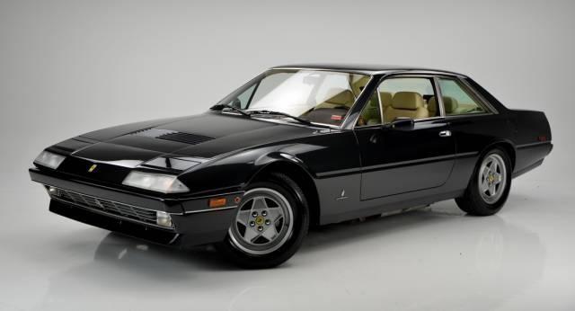 Черный Ferrari 412, купе