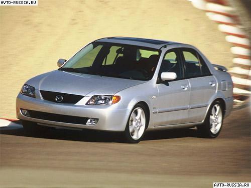 Синяя Mazda Protege: вид спереди
