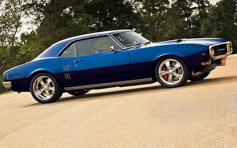 Синий Pontiac Firebrid вид сбоку