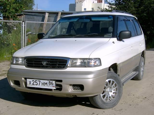 Белый Mazda Efiniti MPV вид спереди