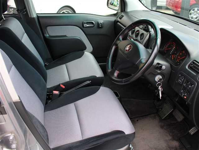 Серый салон, руль Honda Life Dunk