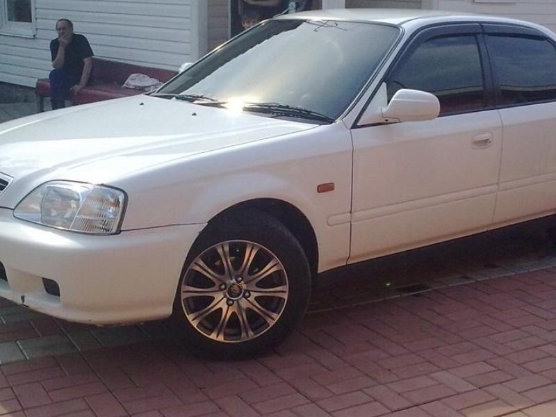Белый Honda Integra SJ