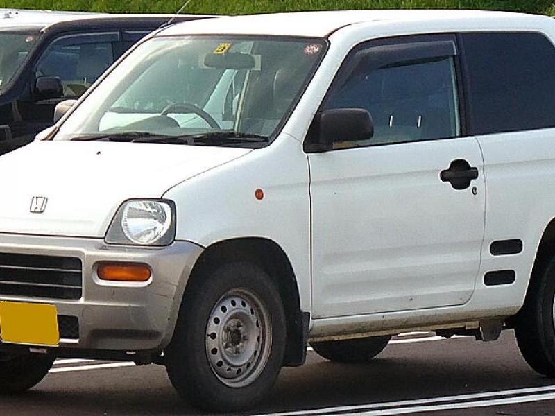 Белый хэтчбек Honda Z вид сбоку
