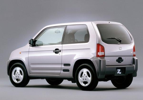 Серебристый Honda Z, вид сбоку