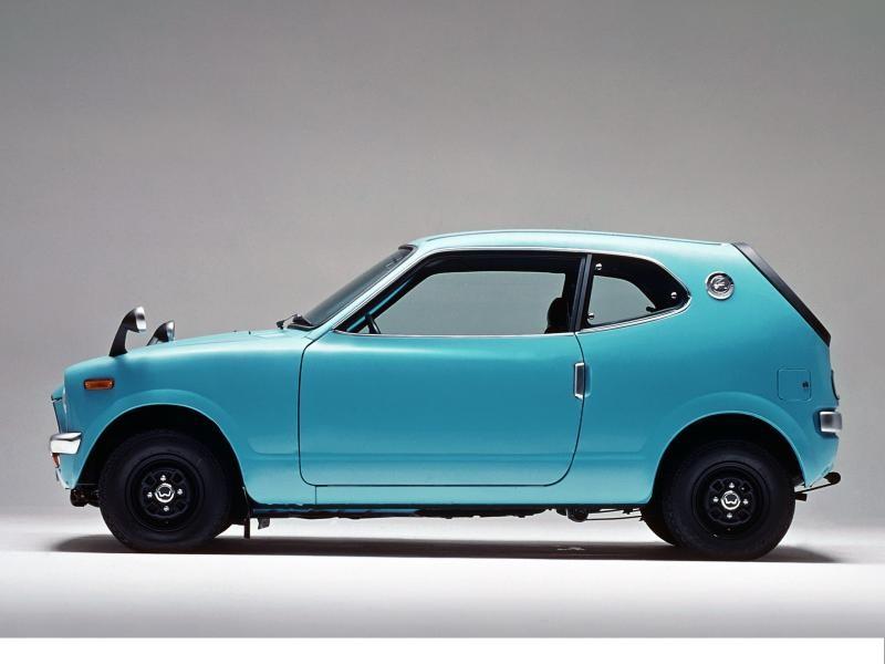 Синий хэтчбек Honda Z вид сбоку