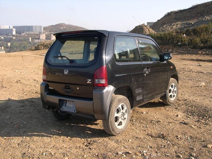 Черный Honda Z вид сзади