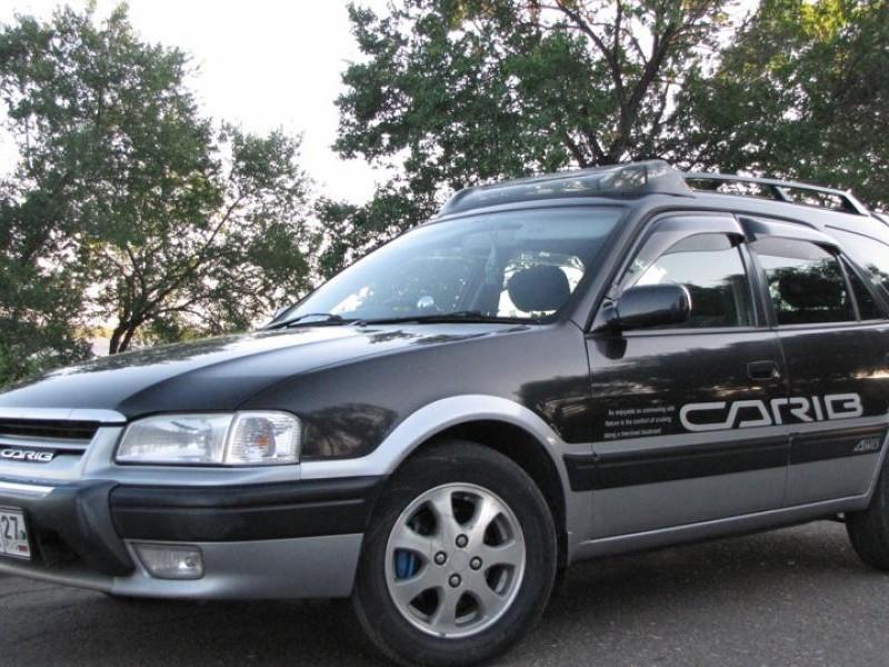 Черный Toyota Sprinter Carib, вид сбоку