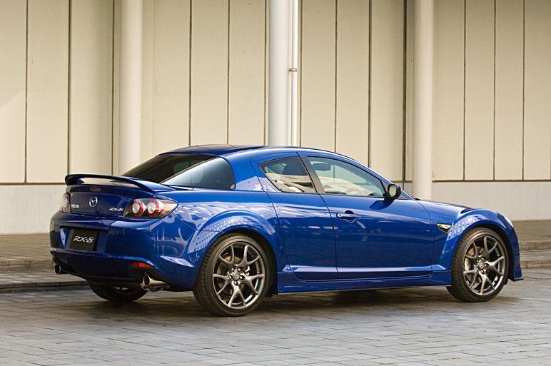 Синий Mazda RX-8 вид сбоку