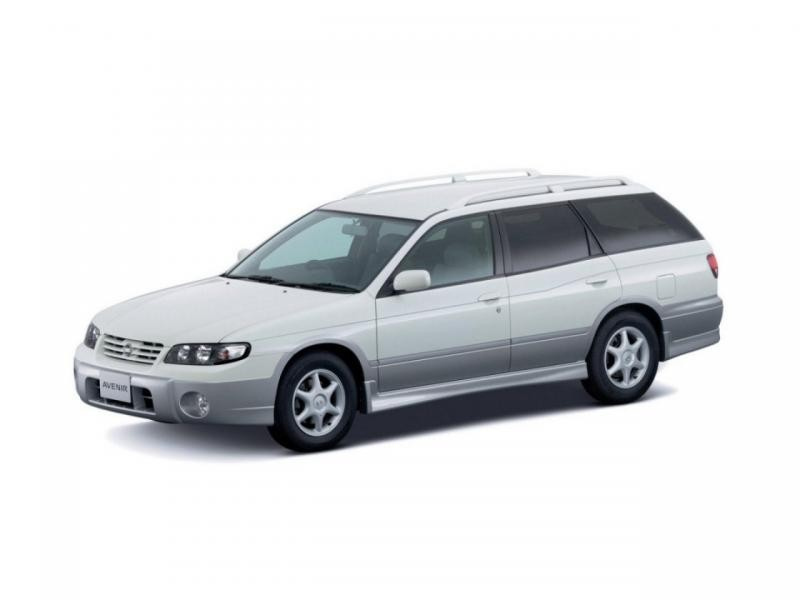 Белый универсал Nissan Avenir вид сбоку