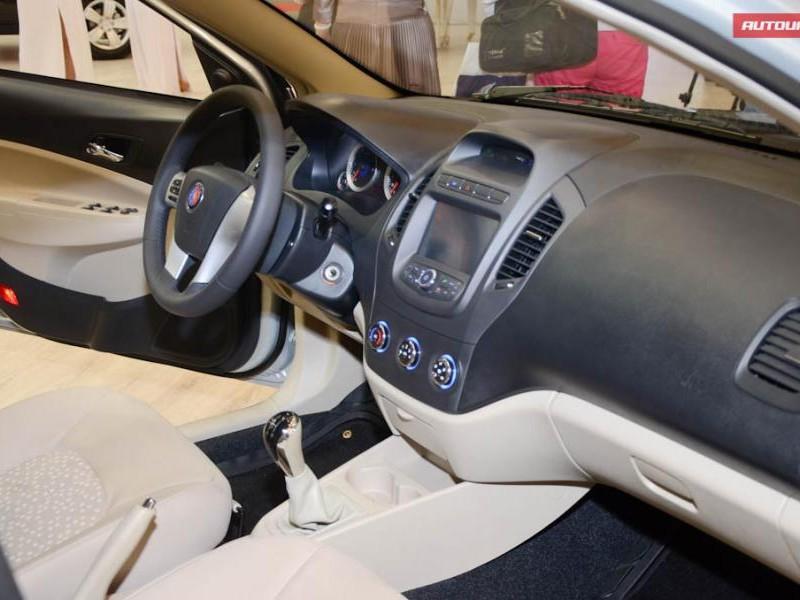 Белый салон, руль, консоль Geely MK 2014