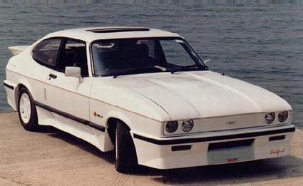 Белый купе Aston Martin Tickford вид спереди