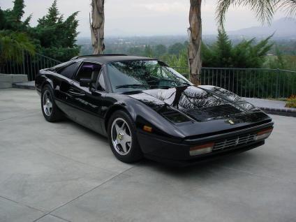 Черный купе Ferrari 328 GTS