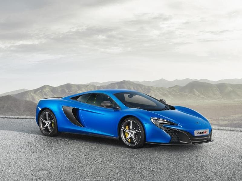 Синий McLaren 650S Coupe вид сбоку