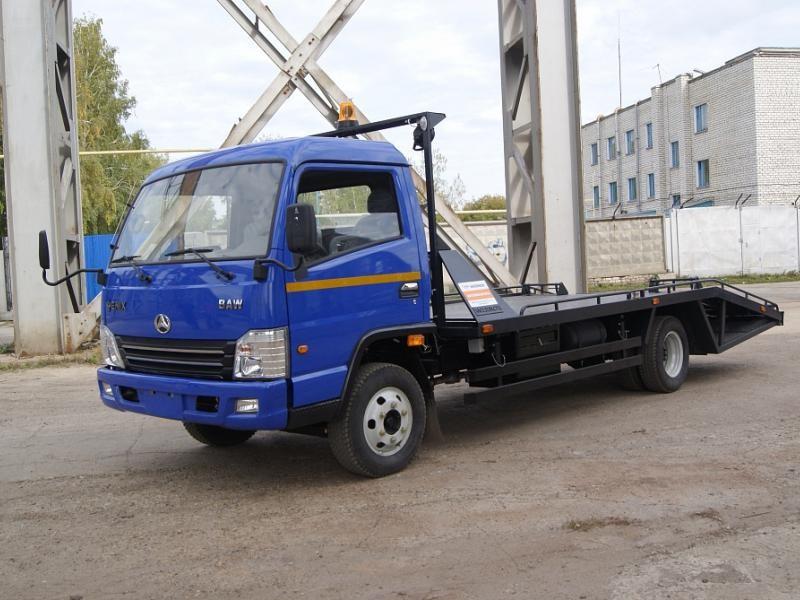 Синий эвакуатор BAW Fenix L 33460 с ломаной платформой СМАРТЭКО