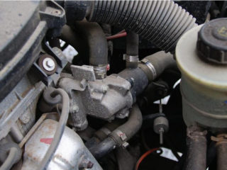 Как проверить и поменять термостат на Renault Logan (Рено Логан)